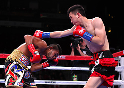 HOUSTON, Jan. 27, 2019  Xu Can (R) of China competes during the competition with Jesus Rojas in Houston, the United States, on Jan. 26, 2019. Xu Can lifted China's first ever World Boxing Association title here on Saturday after he defeated defending champion Jesus Rojas of Puerto Rico by unanimous decision. (Credit Image: © Steven Song/Xinhua via ZUMA Wire)