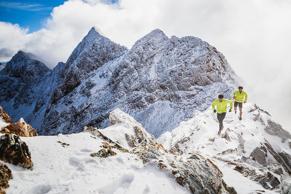 Andy and Jason Dorais head toward Salt Lake Twin Peaks after an early season coat of snow has fallen in the Wasatch Mountains, Utah.