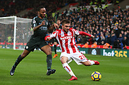 Kostas Stafylidis of Stoke City is challenged by Raheem Sterling of Manchester City. Premier league match, Stoke City v Manchester City at the Bet365 Stadium in Stoke on Trent, Staffs on Monday 12th March 2018.<br /> pic by Andrew Orchard, Andrew Orchard sports photography.