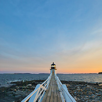 Maine photography of Marshall Point Lighthouse with its white wooden walkway, taken at sunset. This iconic New England lighthouse is located in Port Clyde, ME and marks the entrance to Port Clyde harbor.<br /> <br /> Picturesque Maine lighthouse photography images are available as museum quality photography prints, canvas prints, acrylic prints, wood prints or metal prints. Fine art prints may be framed and matted to the individual liking and interior design decorating needs:<br /> <br /> https://juergen-roth.pixels.com/featured/port-clyde-marshall-point-lighthouse-juergen-roth.html<br /> <br /> Good light and happy photo making!<br /> <br /> My best,<br /> <br /> Juergen<br /> Photo Prints: http://www.rothgalleries.com<br /> Photo Blog: http://whereintheworldisjuergen.blogspot.com<br /> Instagram: https://www.instagram.com/rothgalleries<br /> Twitter: https://twitter.com/naturefineart<br /> Facebook: https://www.facebook.com/naturefineart