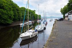 Boats moored on River Almond in Cramond outside Edinburgh in East Lothian, Scotland, united Kingdom