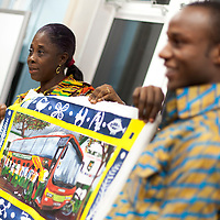 Picture Shows : Madam Juliet Osafo and Ayakwa Kwabena of Juliet Johnson School, Ghana gift  a painting of the bus which Muthill Primary part funded,.Muthill Primary School, Muthill by Crieff, Perthshire, Scotland stage an evening of international cooking to celebrate their joint work with a partner school Juliet Johnson School, Ghana which is visiting this week. They have strong links with the Ghanians and have helped to raise money to contribute toward funding a new school bus.   Feature for TESS..Picture Drew Farrell Tel : 07721-735041