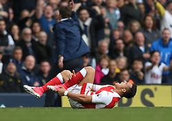30 April 2017 London : Premier League Football : Tottenham Hotspur v Arsenal :<br /> Alexis Sanchez of Arsenal holds his injured leg.<br /> Photo: Mark Leech