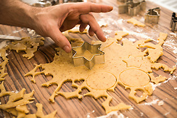 Close-up of a man cutting out star shape cookies, Munich, Bavaria, Germany