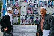 Two ethnic Albanian parents carrying portraits of their missing loved ones are seen wandering around Kosovo's assembly building on Sept 18, 2009. Although the war ended in Kosovo in 1999, thousands of families still demand answers from Serbian and Kosovar officials about their loved ones' whereabouts. Serbia has never apologised for the war crimes committed under Slobodan Milosevic's rule, which led to NATO intervention in March 1999. (Photo/ Vudi Xhymshiti)