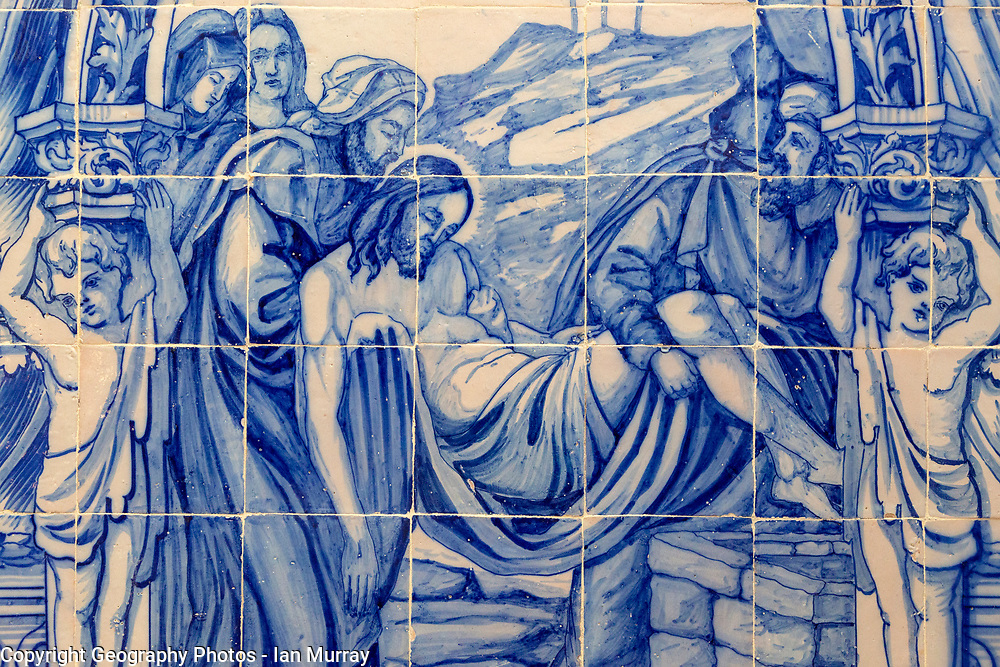 Blue and white traditional Azulejo ceramic tiles forming picture of the death of Jesus Christ being carried away, Evora, Alto Alentejo, Portugal, southern Europe
