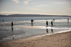 © Licensed to London News Pictures . 13/09/2019. Bournemouth, UK. People paddle in the water in the sea in Bournemouth as a late summer heatwave brings high temperatures to the south coast of England . Photo credit: Joel Goodman/LNP