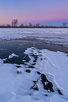 Pink colors linger in the east after sunset at Spring Lake, IL on a frigid winter evening.<br />