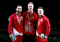 England's Nile Wilson (right) with his gold medal, Canada's Cory Paterson with his Silver medal (centre) and England's James Hall with his Silver medal won in the Men's Horizontal Bar at the Coomera Indoor Sports Centre during day five of the 2018 Commonwealth Games in the Gold Coast, Australia.