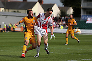 Sean Rigg of Newport county (l) marks Daniel Parslow of Cheltenham closely as he holds onto his shorts.  EFL Skybet football league two match, Newport county v Cheltenham Town at Rodney Parade in Newport, South Wales on Saturday 10th September 2016.<br /> pic by Andrew Orchard, Andrew Orchard sports photography.