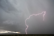 A lightning bolt on display outside of Taos