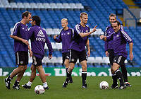 Photo: Daniel Hambury.<br />Anderlecht Training and Press Conference.<br />12/09/2005.<br />Anderlecht's Hanu Tihinnen and team mates share a joke during training.