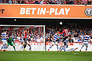 Brentford Midfielder Romaine Sawyers (19) takes a shot at goal during the EFL Sky Bet Championship match between Brentford and Queens Park Rangers at Griffin Park, London, England on 21 April 2018. Picture by Stephen Wright.