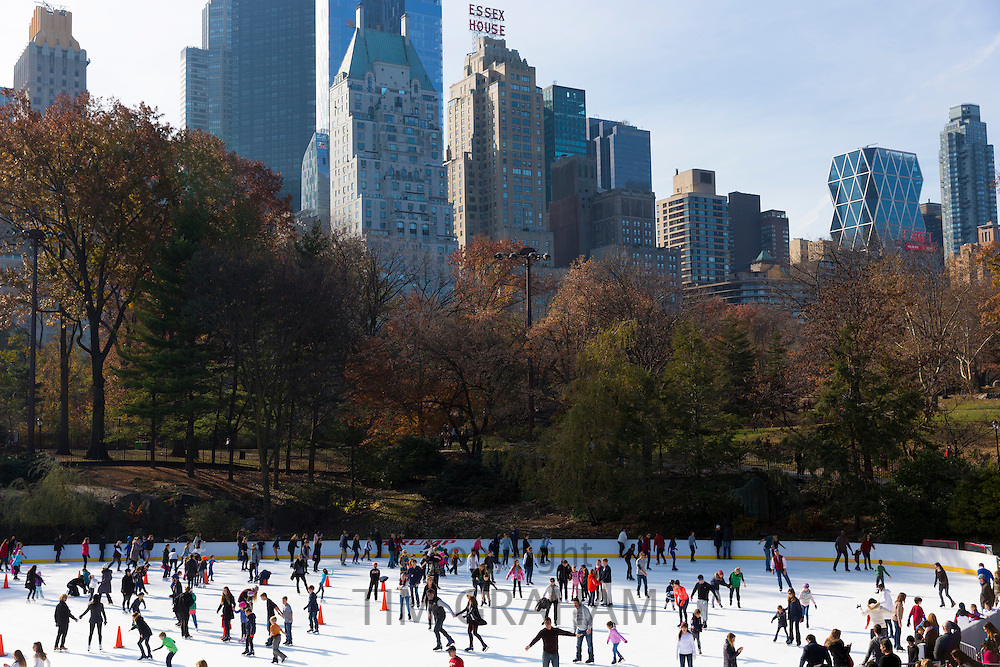 Winter scene of New Yorkers, keen skaters, ice skating at the Wollman Memorial Rink in Central Park, New York, USA
