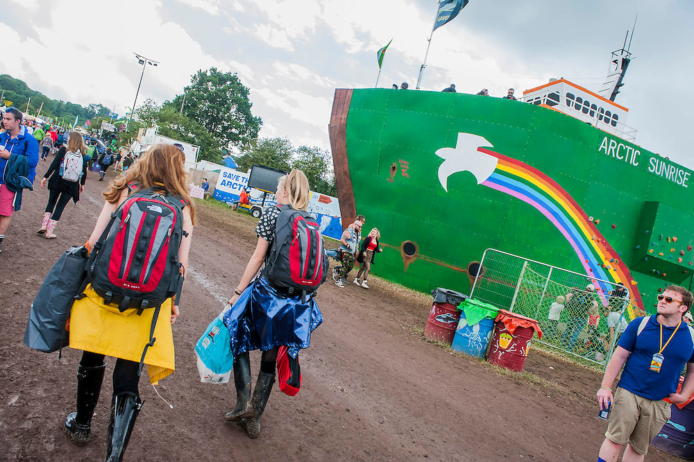 Vivienne Westwood visits the Greenpeace area which includes a huge mock uo of the Arctic Sunrise (pictured), an exhibition of images aof the imprisoned Arctic 30 and a giant animatronic polar bear - all aimed at 'Saving the Arctic'. The 2014 Glastonbury Festival, Worthy Farm, Glastonbury. 27 June 2013.