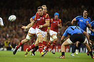 Gareth Davies of Wales passes the ball wide. Rugby World Cup 2015 pool A match, Wales v Uruguay at the Millennium Stadium in Cardiff, South Wales  on Sunday 20th September 2015.<br /> pic by  Andrew Orchard, Andrew Orchard sports photography.