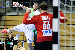 Blaz Blagotinsek of Slovenia vs Andreas Wolff of Germany during handball match between National Teams of Germany and Slovenia at Day 2 of IHF Men's Tokyo Olympic  Qualification tournament, on March 13, 2021 in Max-Schmeling-Halle, Berlin, Germany. Photo by Vid Ponikvar / Sportida