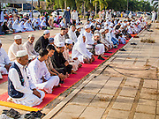 28 JULY 2014 - KHLONG HAE, SONGKHLA, THAILAND: Men pray before Eid services at Songkhla Central Mosque in Songkhla province of Thailand. Eid al-Fitr is also called Feast of Breaking the Fast, the Sugar Feast, Bayram (Bajram), the Sweet Festival and the Lesser Eid, is an important Muslim holiday that marks the end of Ramadan, the Islamic holy month of fasting.   PHOTO BY JACK KURTZ