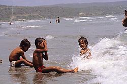 Three Boys Playing At The Beach