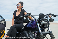 Samantha Campana and the Iron Lillies on the beach for the Hot Leathers ride during the Daytona Bike Week 75th Anniversary event. FL, USA. Tuesday March 8, 2016.  Photography ©2016 Michael Lichter.