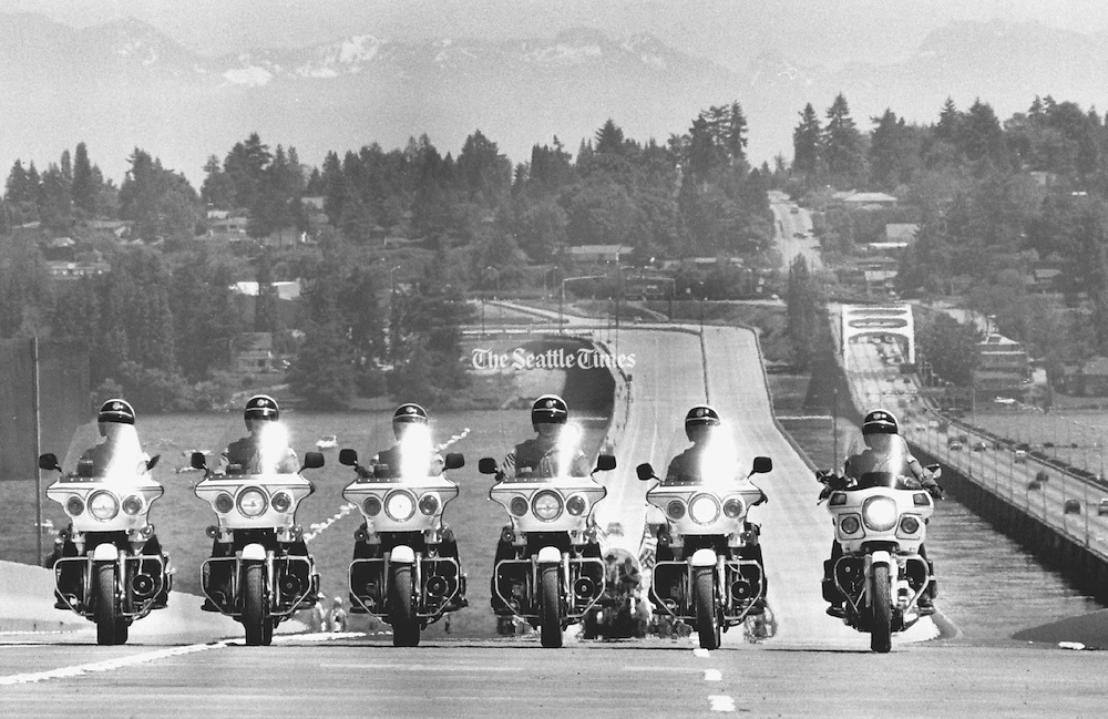 Washington State Police motorcycle troopers led the opening procession for vehicles across the new I-90 span, followed by a caravan of covered wagons, Metro buses and other automobiles. The westbound span opened for the general public shortly after. (The Seattle Times, 1989)