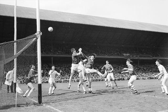 Cork's full forward B. Cummins punches the ball across the bar as the Sligo defenders look on helplessly during the All Ireland Minor Gaelic Football Final Sligo v. Cork in Croke Park on the 22nd September 1968. Cork 3-5, Sligo 1-10.