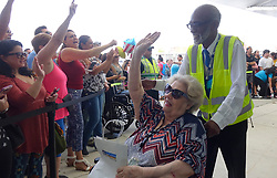 A Caribbean hurricane evacuee who arrived on board the Royal Caribbean Adventure of the Seas, react tot he waiting crowd, Tuesday, Oct. 3, 2017, at Port Everglades in Fprt Lauderdale. More than 3,000 people from Puerto Rico and the U.S. Virgin Islands were brought to Florida on board the Royal Caribbean Adventure of the Seas, Tuesday, Oct. 3, 2017, at Port Everglades in Fort Lauderdale. Photo by Joe Cavaretta/Sun Sentinel/TNS/ABACAPRESS.COM