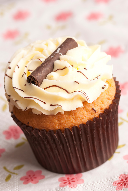 Delicious cupcakes topped with chocolate and buttercream