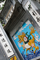 The entrance gate to Ngoc Son Temple is a colourful piece of art.