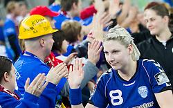 Tamara Mavsar of Krim Mercator with fans Krimovci after the handball match between RK Krim Mercator and CS Oltchim RM Valcea (ROU) of Women's EHF Champions League 2011/2012, on February 4, 2012 in Arena Stozice, Ljubljana, Slovenia. Valcea defeated Krim 31-25. (Photo By Vid Ponikvar / Sportida.com)