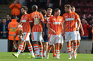 Blackpool celebrate their 1-0 win over Scunthorpe at the end of the Sky Bet League 1 match between Scunthorpe United and Blackpool at Glanford Park, Scunthorpe, England on 5 September 2015. Photo by Ian Lyall.