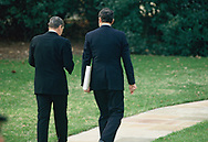 President Reagan with William Clark walking  towards the Oval Office of  the While House.<br />Photo by Dennis Brack