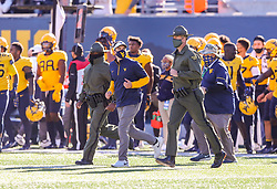 Oct 31, 2020; Morgantown, West Virginia, USA; West Virginia Mountaineers head coach Neal Brown runs to midfield after defeating the Kansas State Wildcats at Mountaineer Field at Milan Puskar Stadium. Mandatory Credit: Ben Queen-USA TODAY Sports
