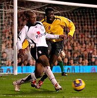 Photo: Ed Godden.<br /> Fulham v Arsenal. The Barclays Premiership. 29/11/2006.<br /> Fulham's Luis Boa Morte (L) gets the ball past Kolo Toure.