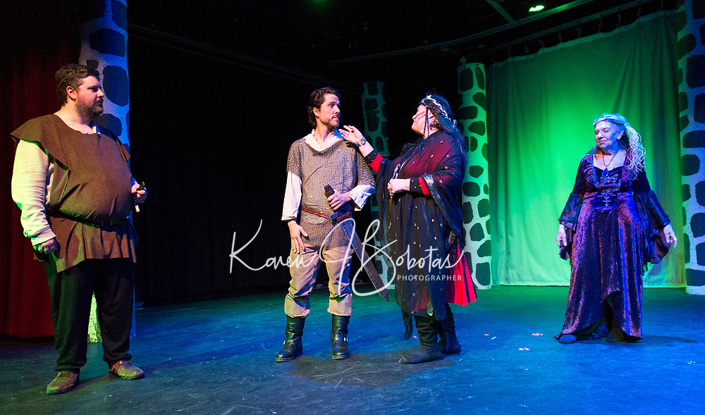 """Brendan Berube (Macbeth), Ray Feola (soldier), Kristine Snow and Evelyn Taylor (witches) during dress rehearsal for """"Macbeth"""" with the Streetcar Company Theater at Laconia High School.  (Karen Bobotas/for the Laconia Daily Sun)"""