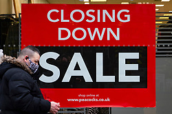 Motherwell, Scotland, UK. 1 November 2020. The Scottish Government today announced that from Friday 20 November, the most severe level 4 lockdown will be introduced in eleven Scottish council areas. This means non essential shops will close and bars, restaurants and cafes. Pictured; Closing down sale sign in  shop on shopping arcade.    Iain Masterton/Alamy Live News