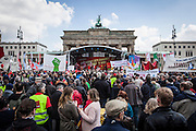 01/05/2015 – Berlin, Germany: People listen the speech of a member of DGB, the Confederation of German Trade Unions in front of the Brandenburg gate to celebrate the International Workers Day. The International Workers Day is a celebration of laborers and the working classes that is promoted by the international labor movement, anarchists, socialists, and communists and occurs every year on May Day. (Eduardo Leal)