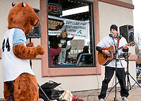 There was some dancing going on at Burrito Me with the Muskrat's mascot, Paul Warnick and inside keeping warm Remy Bassett at the conclusion of the Frozen 5K race to benefit the WLNH Children's Auction.   (Karen Bobotas/for the Laconia Daily Sun)