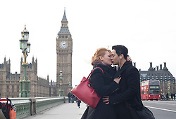 © licensed to London News Pictures. London, UK 14/02/2012. Sophie Young and Keanu Alpha enjoying Valentine's Day on Westminster Bridge, London. Photo credit: Tolga Akmen/LNP