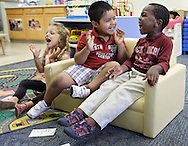 Errol McKinson, right, Carlos Granados, center, and Lila Munoz enjoy a sing-along at the Early Head Start program in Woodbourne, N.Y., on Tuesday, July 23, 2013. Sullivan County Head Start has cut enrollment and staff in response to the across-the-board federal funding cuts known as the sequester.