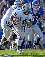 Kansas State running back Leon Patton (14) rushes the ball up field against Kansas at Memorial Stadium in Lawrence, Kansas, November 18, 2006.  Kansas beat K-State 39-20.<br />