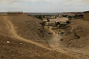 Tchikuteny?s village at Giraul. There is two years since the last rain. In Angola?s Namibe desert, at Giraul, in the Namibe province, Tchikuteny, from the Mucubal tribe, is the leader of a big family, maybe the biggest family in the world.<br /> He is the chief leader, the manager and responsible for the entire village. <br /> In his village, Tchikuteny lives nowadays with most of his big family, his 33 wives, that were once 43, but 10 left the village, and most of their descendants.<br /> Tchikuteny maintains the registry of all the new-borns, totalizing 154 sons, and his grandsons, that are around 60. Nowadays, 4 new babies are on the way, and 3 great grand children were born recently.<br /> Huge harmony, love and respect transpire in the village atmosphere. The sense of a community is the pillar of their sustainability and sustenance and their autonomy depends prominently on cattle and agriculture that is made by the villagers. Nevertheless, Tchikuteny village is in close connection with their surrounding communities. Children attend Giraul School and there is proximity and relations with the extended family that lives in the surroundings.<br /> Being the spiritual leader of the community, Tchikuteny is also responsible for the weekly religious works that happens in the village church. <br /> This big family opened his doors to share with us their daily lives.