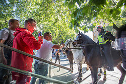 © Licensed to London News Pictures. 13/06/2020. London, UK. A mounted policeman confronts far-right protesters in central London. Police have imposed strict restrictions on groups planning to protest in London Saturday in a bid to avoid violent clashes between protesters from the Black Lives Matter movement, as well as far-right groups. Photo credit: Marcin Nowak/LNP