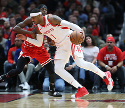 November 3, 2018 - Chicago, IL, USA - Houston Rockets forward Carmelo Anthony (7) dribbles past the defense of Chicago Bulls forward Justin Holiday (7) in the first quarter at the United Center Saturday, Nov. 3, 2018, in Chicago. The Rockets beat the Bulls 96-88. (Credit Image: © John J. Kim/Chicago Tribune/TNS via ZUMA Wire)