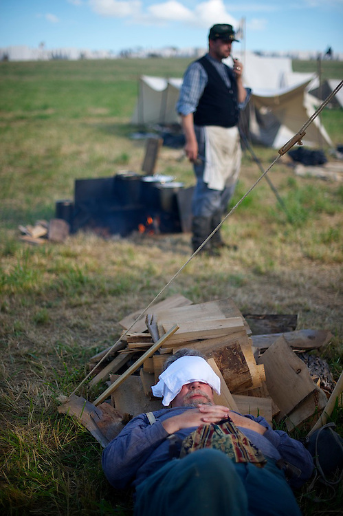 A union reenactor slumbers during battle on the second of a four day Gettysburg Anniversary Committee 150th Gettysburg reenactment in Gettysburg, PA on July 5, 2013.