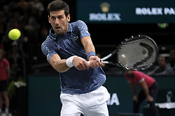 November 1, 2018 - Paris, France - Serbian player NOVAK DJOKOVIC returns the ball to Bosnian player Damir Dzumhur during the Rolex Paris Masters at Paris AccorHotel Arena Stadium in Paris France. Withdrawal of Damir Dzumhur on injury. Djokovic won 6:1 2:1 (Credit Image: © Pierre Stevenin/ZUMA Wire)