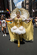 New York, NY - 30 June 2019. The New York City Heritage of Pride March filled Fifth Avenue for hours with participants from the LGBTQ community and it's supporters. A man in a gold costume with wings.