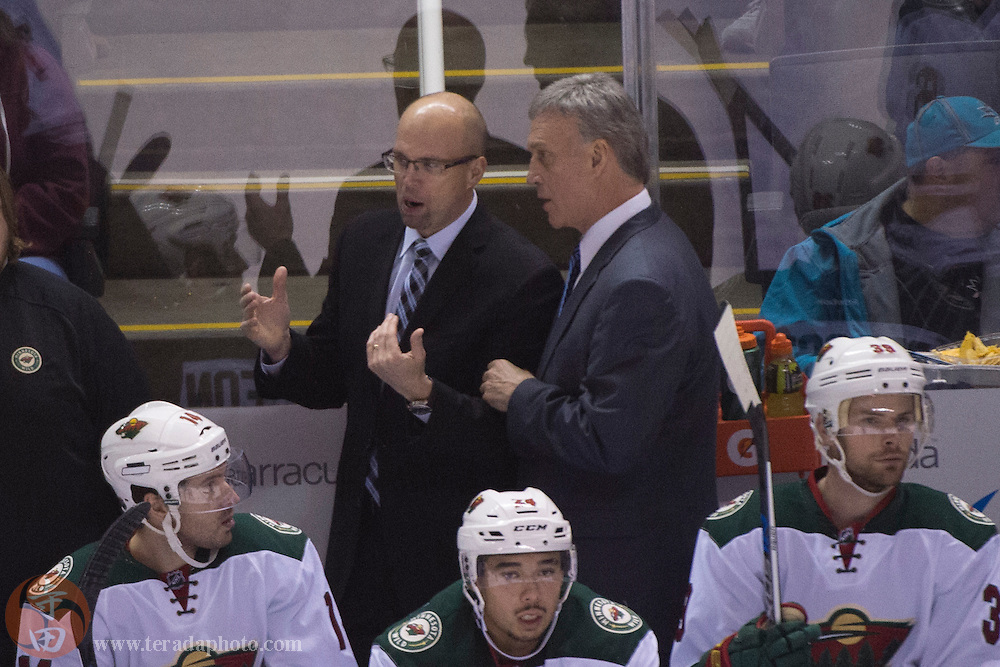 December 12, 2015; San Jose, CA, USA; Minnesota Wild head coach Mike Yeo (left) talks to assistant coach Rick Wilson (right) during the third period against the San Jose Sharks at SAP Center at San Jose. The Wild defeated the Sharks 2-0.