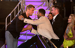 Dan Osborne hakes hands with Jermaine Pennant after he leaves the house after finishing in third place during the live final of Celebrity Big Brother at Elstree Studios, Hertfordshire.