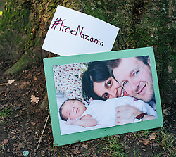 © Licensed to London News Pictures. 25/11/2017. London, UK. A picture of British Iranian Nazanin Zaghari-Ratcliffe, her husband Richard Ratcliffe and their daughter, at a demonstration in London. Nazanin Zaghari-Ratcliffe remains in prison in Iran. Photo credit: Rob Pinney/LNP